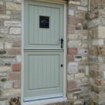 sage green stable door with black door handle