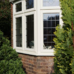 white wooden bay window with grid