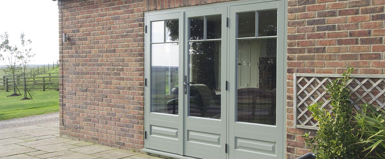 sage green wooden patio doors