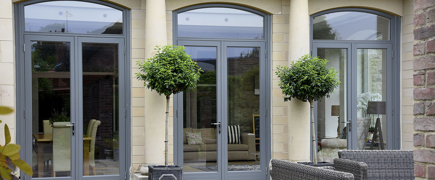 six large grey wooden back doors