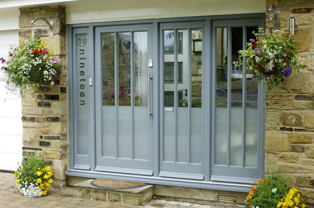 grey wood front door with long windows