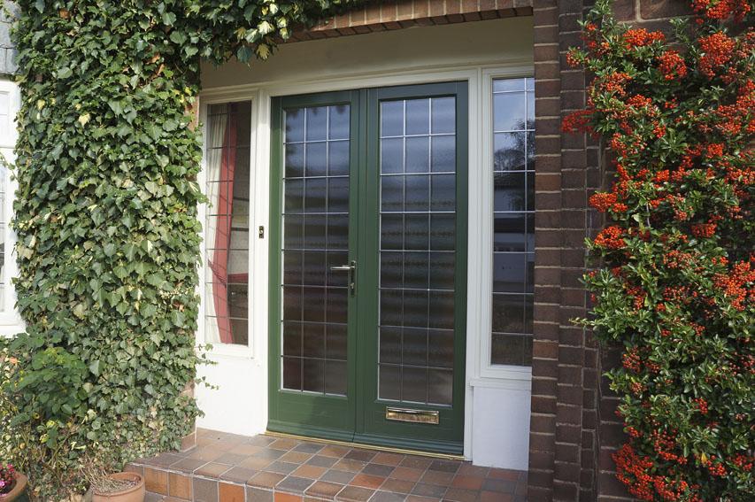 green wooden front porch doors