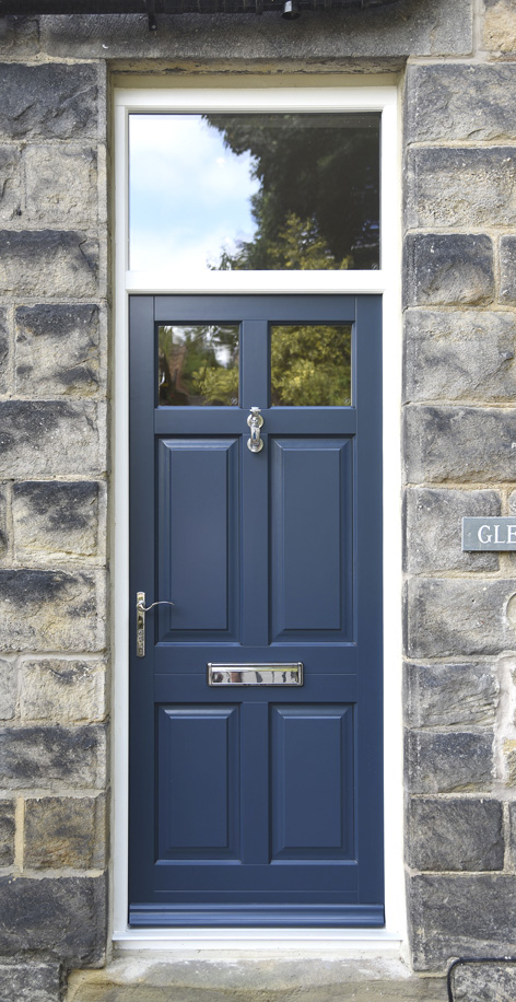navy coloured wooden door with silver handle and letterbox