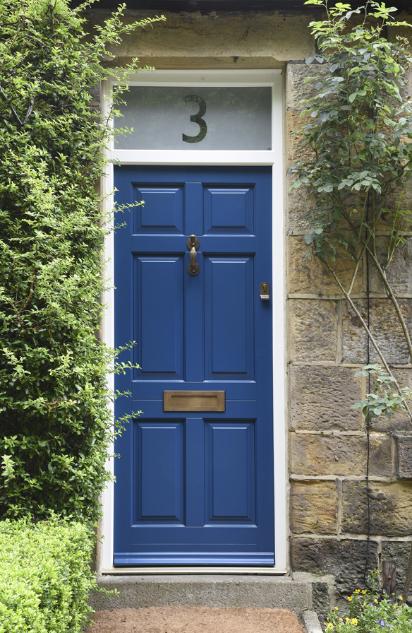 blue wooden front door with brass accents