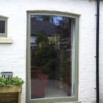 large sage green wooden window
