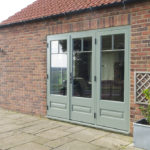sage green wooden patio doors