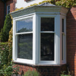 large wooden front sash bay windows