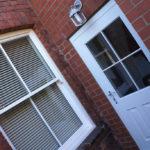 white wooden door and sash window