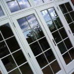 white wooden french doors with grid