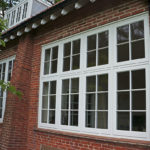 large white wooden windows with panelling
