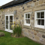white wooden french doors and sash windows