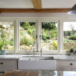 kitchen view of cream wooden windows