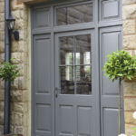 large grey wooden front door