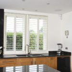 kitchen view of white wooden windows