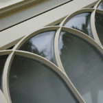 cream arched wooden windows