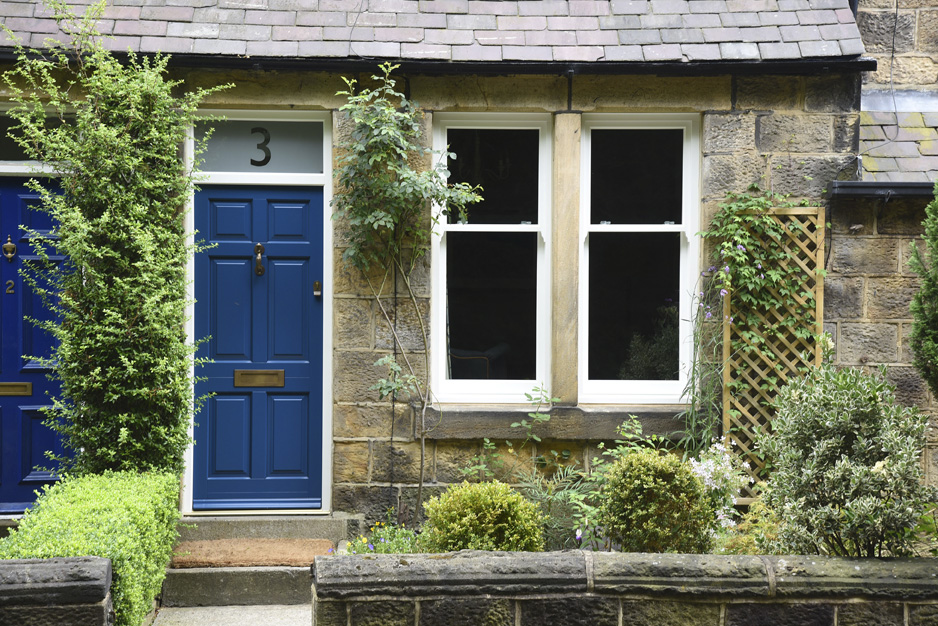 blue wooden front door with white wood windows
