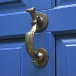 blue wooden door with brass door knocker