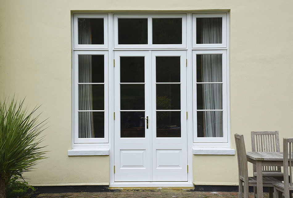 white wood double doors and windows