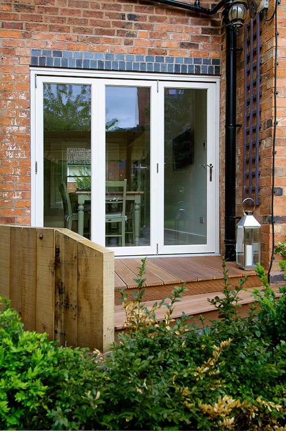 white bifold patio doors with 3 large windows