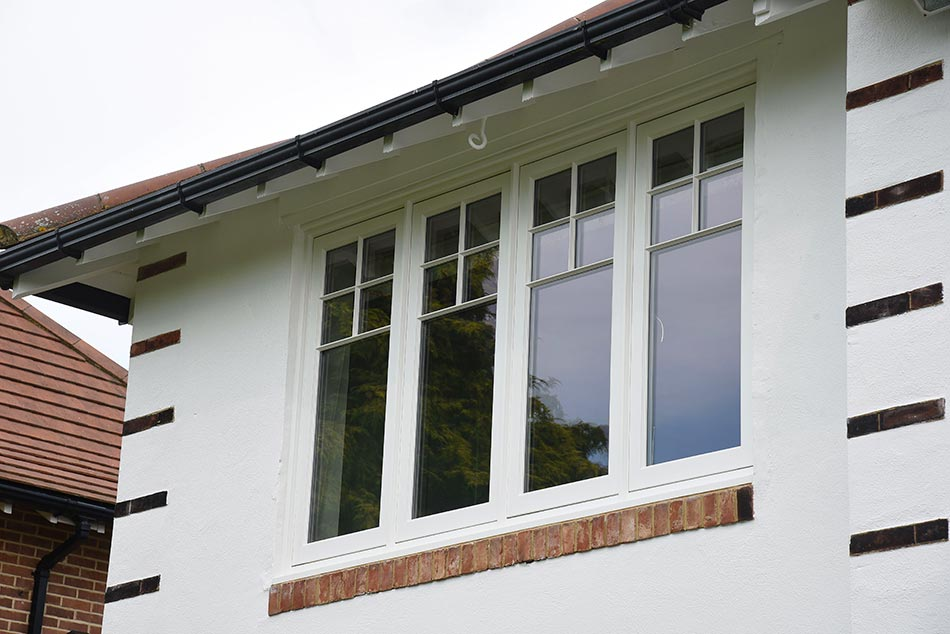 four white wood panelled upstairs windows