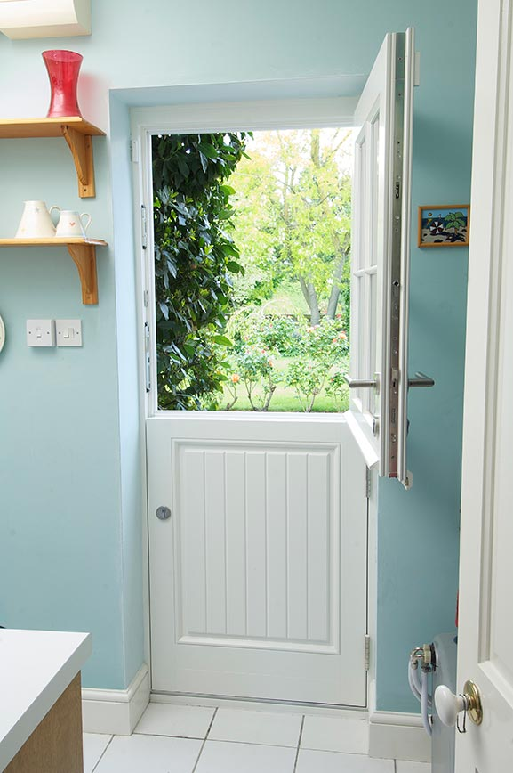 White wooden stable door with silver handles