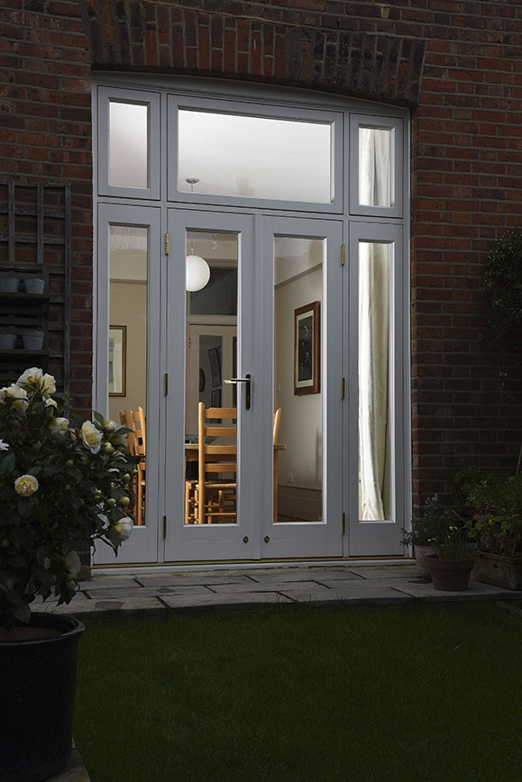 white wooden patio doors at night