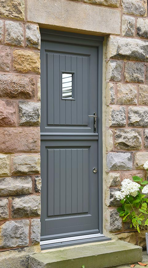 grey wooden barn door with silver handle