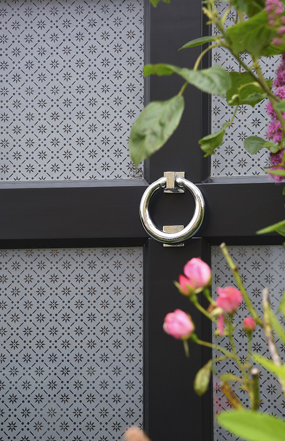 Black wooden door with silver door knocker