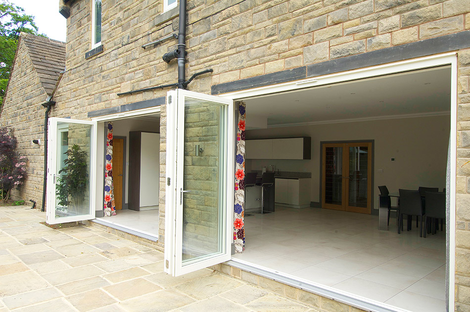 open white wooden bifold patio doors
