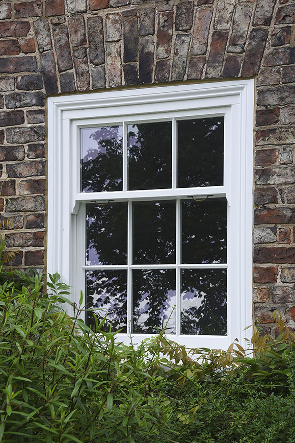 white wooden panelled front window