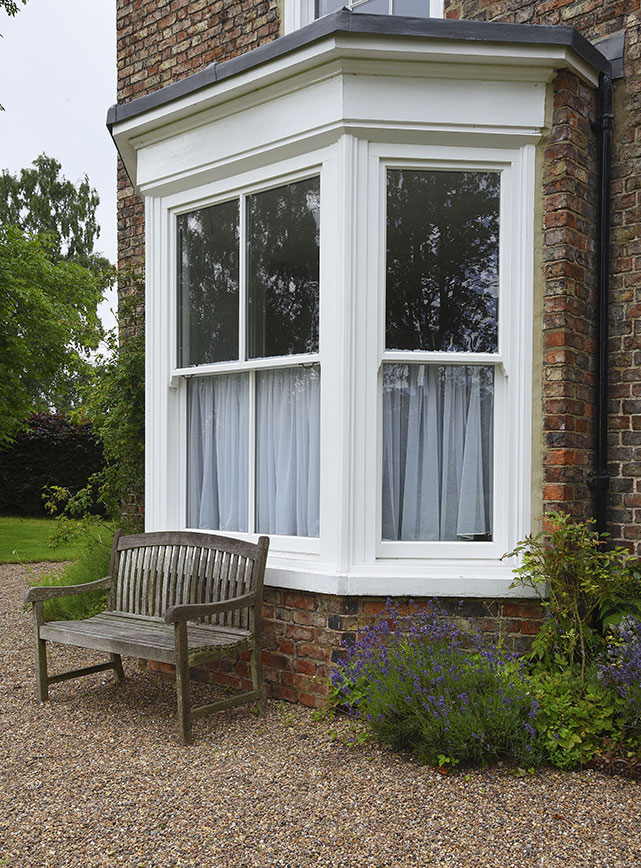 white wood bay window