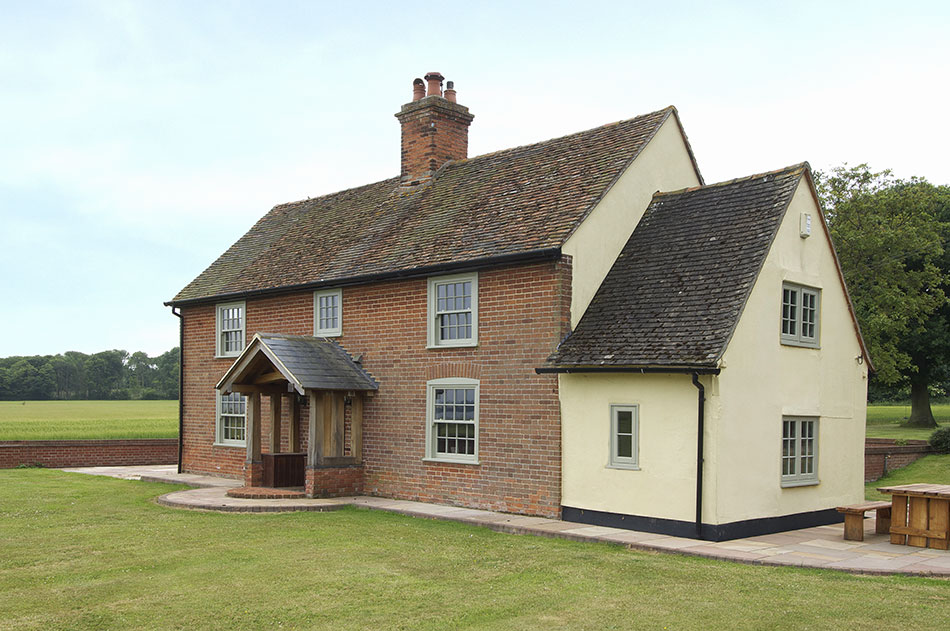 house with green timber windows