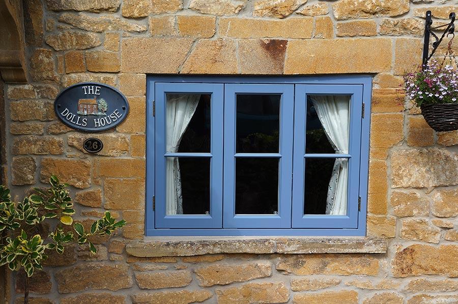 light blue wooden casement windows