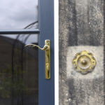 blue wooden front door with gold shiny handle