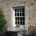 white wooden sash windows with grid