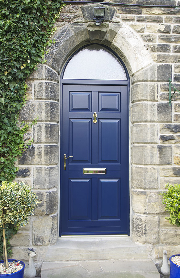 blue wooden door with gold handle and letterbox