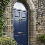 blue wooden front door with arched window
