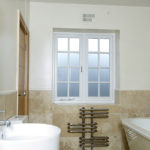 white wooden bathroom windows