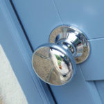 blue wooden front door with silver door knob