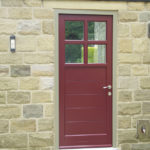 red wooden front door with windows