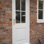 white wooden door with silver handle