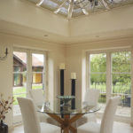 dining room view of white wooden french doors and windows