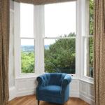 white wooden sash bay window