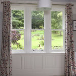 white sash window view from bedroom