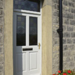 white wooden front door with stained glass windows