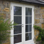 white wooden french patio doors