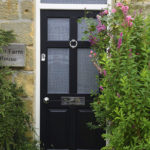 black wooden front door with silver accents