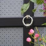 Black wooden door with silver door knocker