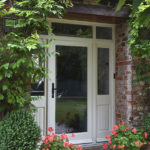white wooden front door with white wood side windows