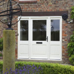 large white wooden front door with large windows